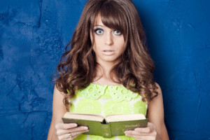 Young Woman Reading Shocking