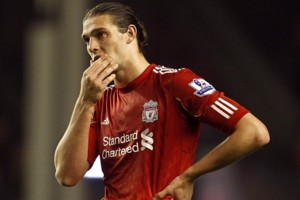 Liverpool's Andy Carroll stands dejected