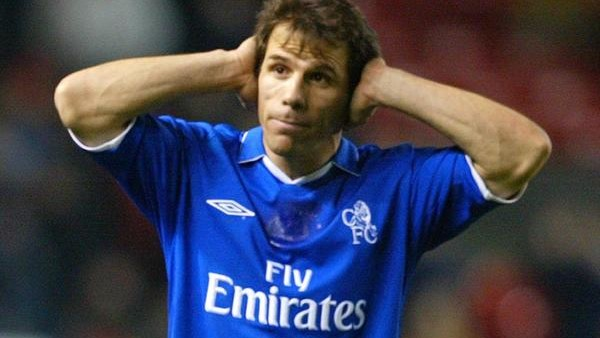 Chelsea's Gianfranco Zola holds his head in his hands after his side were beaten 1-0 by Manchester United, during their Worthington Cup 5th Round match at Old Trafford. THIS PICTURE CAN ONLY BE USED WITHIN THE CONTEXT OF AN EDITORIAL FEATURE. NO WEBSITE/I