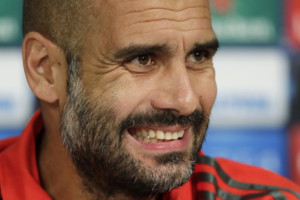 Bayern's head coach Pep Guardiola attends a press conference ahead of Wednesday's Champions League group E soccer match between FC Bayern Munich and Manchester City, in Munich, southern Germany, Tuesday, Sept. 16, 2014. (AP Photo/Matthias Schrader
