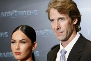 FILE - In this June 14, 2009 file photo, film director and executive producer Michael Bay, right, poses with actress Megan Fox as they arrive for the German premiere of their movie