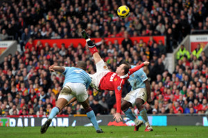 File photo dated 12/02/2011 of Manchester United's Wayne Rooney (centre) scoring their second goal from inside the penalty area from an overhead kick.
