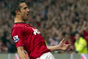 Manchester United's Robin van Persie reacts after scoring a goal against Fulham, during their English Premier League soccer match at Old Trafford Stadium, Manchester, England, Saturday, Aug. 25, 2012. (AP Photo/Jon Super)