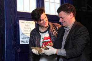 Actor Matt Smith (left), the current Dr Who, watches as Doctor Who lead writer Steven Moffat, casts his hand prints in cement, during his first visit to The Doctor Who Experience in Cardiff Bay, to unveil a new exhibit of monsters and props from series 7.