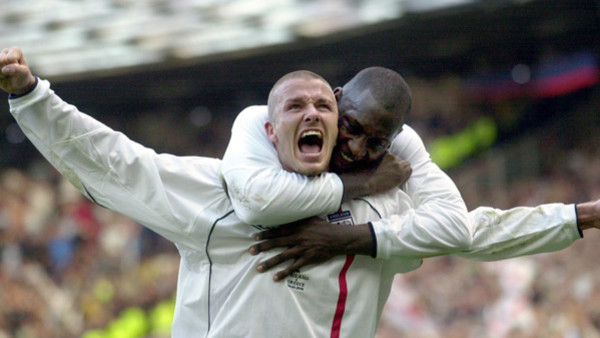 FILE - This is a Saturday, Oct. 6, 2001 file photo of England's captain David Beckham, left, as he is congratulated by teammate Emile Heskey after scoring their second goal against Greece during their 2002 World Cup qualifying match at Old Trafford Manche