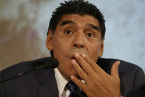 Former Argentine's soccer star Diego Armando Maradona talks during a press conference in Milan, Italy, Thursday, Oct. 17, 2013. Diego Maradona would like to coach his former club Napoli. The Argentina great was in Milan on Thursday to promote a video