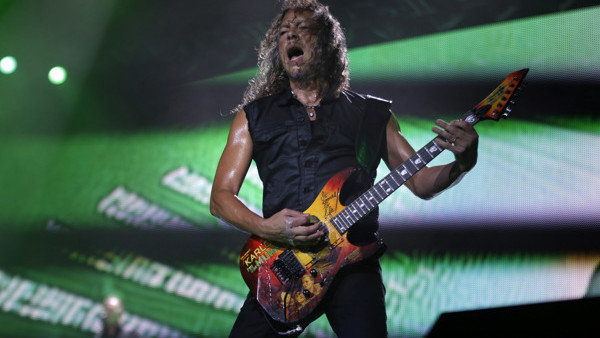 Metallica's lead guitarist Kirk Hammett performs during a concert in Asuncion, Paraguay, Monday, March 24, 2014.(AP Photo/Jorge Saenz)