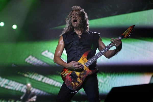 Metallica's lead guitarist Kirk Hammett performs during a concert in Asuncion, Paraguay, Monday, March 24, 2014.(AP Photo/Jorge Saenz)