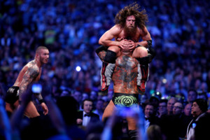 Randy Orton, left, Daniel Bryan, top, and Batista compete during Wrestlemania XXX at the Mercedes-Benz Super Dome in New Orleans on Sunday, April 6, 2014. (Jonathan Bachman/AP Images for WWE)