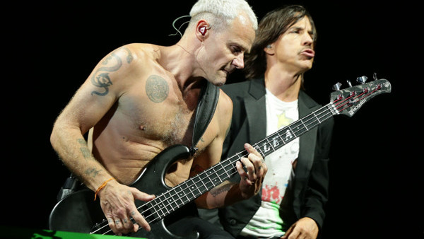 Flea and Anthony Kiedis of the Red Hot Chilli Pepers performing on the Main Stage, at the Isle of Wight Festival in Seaclose Park, Newport, Isle of Wight.