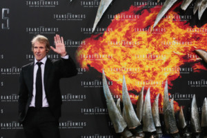 US director Michael Bay poses for photographers, during the European premiere of the film 'Transformers: Age of Extinction', at Potsdamer Platz in Berlin, Sunday, June 29, 2014. (AP Photo/Markus Schreiber)