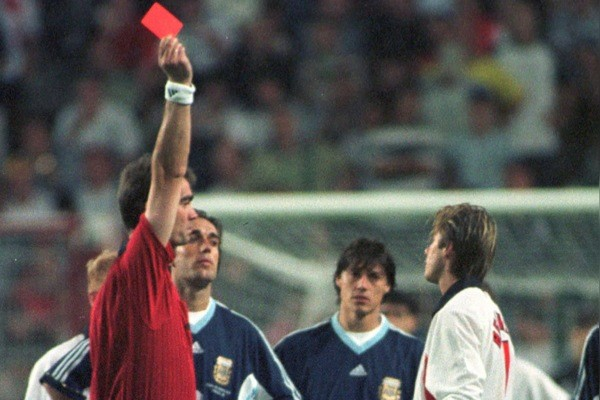 FILE - In this June 30, 1998 file photo, England's David Beckham receives a red card from Danish referee Kim Milton Nielsen, during England's World Cup second round soccer match against Argentina, in Saint Etienne, France. On this day: Beckham bec