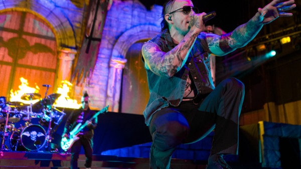 This July 5, 2014 photo shows M. Shadows of Avenged Sevenfold performing at the Rockstar Energy Drink Mayhem Festival at San Manuel Amphitheater in San Bernardino, Calif. (Photo by Paul A. Hebert/Invision/AP)