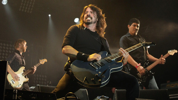 File photo dated 14/5/2011 of Dave Grohl (centre) of the Foo Fighters. Prince Harry is to rock out with Foo Fighters and Kaiser Chiefs after they were signed up to head the bill for the closing ceremony of the Invictus Games which he launched.