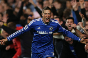 FILE - In this Sunday, Oct. 27, 2013, file photo, Chelsea's Fernando Torres celebrates after scoring the winning goal during the English Premier League soccer match between Chelsea and Manchester City. Chelsea says it has agreed terms with AC Milan fo