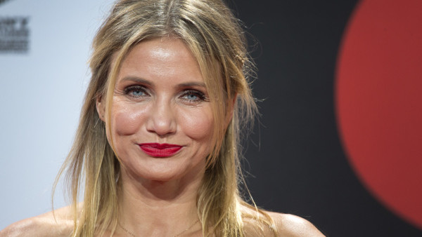 US actress Cameron Diaz poses for the media prior to the Germany premiere of the movie 'Sex Tape' in Berlin, Germany, Friday, Sept. 5, 2014. (AP Photo/Michael Sohn)