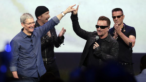 FILE - In this Sept. 9, 2014 file photo, Apple CEO Tim Cook, left, greets Bono from the band U2 after they preformed at the end of the Apple event on Tuesday, Sept. 9, 2014, in Cupertino, Calif. Apple unveiled a new Apple Watch, the iPhone 6 and Apple Pay