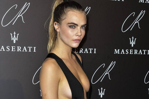 Cara Delevingne poses at to Carine Roitfeld & Stephen Gan celebration of the launch of CR Fashion Book N.5 in Paris, Tuesday, Sept. 30, 2014.(AP Photo/Zacharie Scheurer)