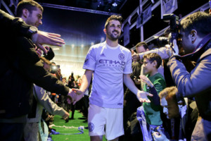 Spanish soccer star David Villa is greeted by fans as he walks down the aisle wearing the jersey to be worn by players on Major League Soccer's new team, the New York City Football Club, during an introductory celebration, Thursday, Nov. 13, 2014, in New