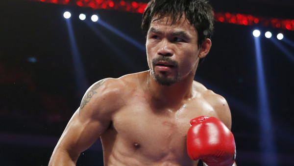 WBO welterweight champion Manny Pacquiao of the Philippines, fights during his world welterweight title boxing match against WBO junior welterweight champion Chris Algieri of the U.S. at the Venetian Macao in Macau, Sunday, Nov. 23, 2014. (AP Photo/Kin Ch
