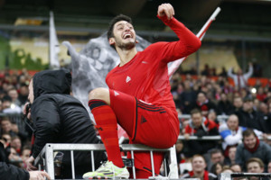 Leverkusen's Hakan Calhanoglu from Turkey celebrates with supporters after winning the German first division Bundesliga soccer match between Bayer Leverkusen and 1.FC Cologne in Leverkusen, Germany, Saturday, Nov. 29, 2014. (AP Photo/Frank Augstein)