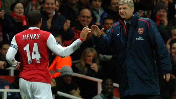 Arsenal's Thierry Henry, left, stands with his manager Arsene Wenger during presentations after beating Wigan Athletic in their final English Premier League soccer match at Arsenal's Highbury stadium against Wigan Athletic, Sunday May 7, 2006. Highbury ho