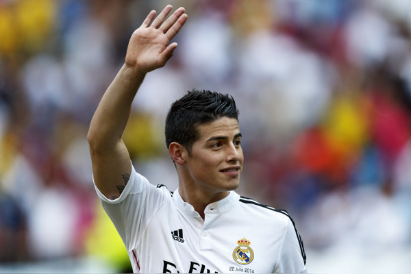 FILE - In this July 22, 2014, file photo, Real Madrid player James Rodriguez, from Colombia, waves during his official presentation at the Santiago Bernabeu stadium in Madrid, Spain. Rodriguez has been named sportsman of the year in his native Colombia, T