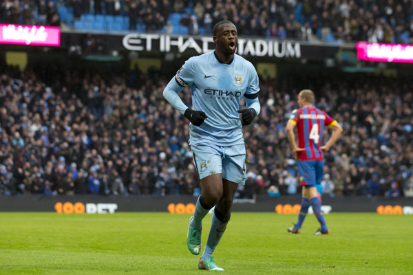 Manchester City's Yaya Toure celebrates after scoring against Crystal Palace during the English Premier League soccer match between Manchester City and Crystal Palace at the Etihad Stadium, Manchester, England, Saturday Dec. 20, 2014. (AP Photo/Jon Su
