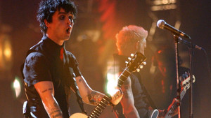 Green Day perform live on stage.