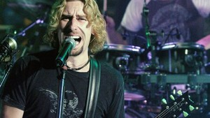 Chad Kroeger, left, and drummer Daniel Adair of Nickelback perform at MuchMusic in Toronto Thursday Oct. 13, 2005. (AP Photo/CP, Aaron Harris)