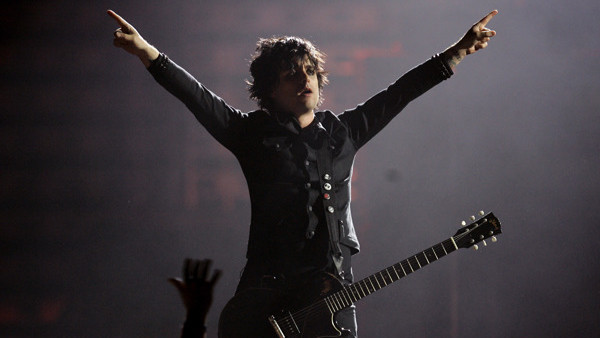 Billy Joe Armstrong, lead singer of Green Day, performs during the MTV Europe Music Awards ceremony Thursday, Nov. 3, 2005, at the Atlantic Pavillion in Lisbon, Portugal. Green Day won both the Best Rock and Best Album awards. (AP Photo/Armando Franca)