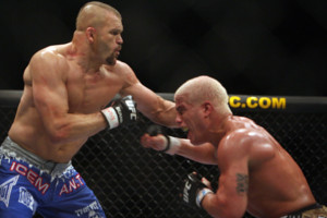 Ultimate Fighting Championship light heavyweight champion Chuck Liddell, left, and Tito Ortiz, right, spar in the second round of their fight in Las Vegas on Saturday, Dec. 30, 2006. Liddell won to retain his title. (AP Photo/Marlene Karas)