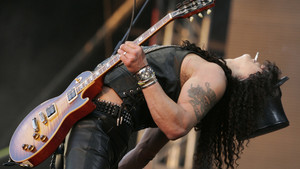 Velvet Revolver's Slash performs at the Live 8 concert in Hyde Park, London, Saturday July 2, 2005. The concert was part of a series of free concerts being held around the world designed to press leaders of the rich G8 countries to help impoverished Afric