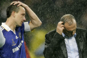 ** FILE ** In this Wednesday May 21, 2008 file photo Chelsea's captain John Terry, 2nd left, and manager Avram Grant react at the end of the Champions League final soccer match at the Luzhniki Stadium in Moscow. United beat Chelsea 6-5 on penalties after