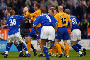 Everton's Duncan Ferguson lashes out at Leicester City's Steffen Freund after being shown a red card