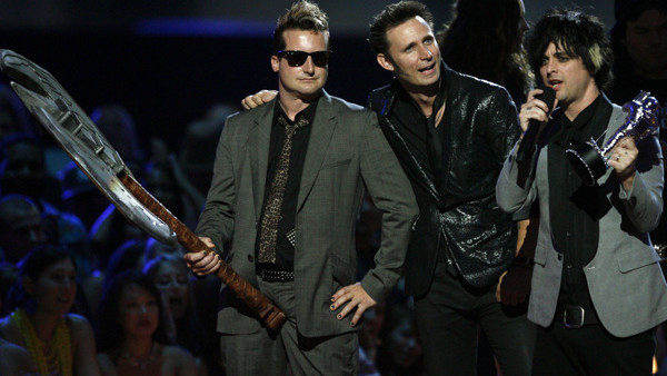 The band Green Day, from left to right, Tre Cool, Mike Dirnt, and Billy Joe Armstrong, accept the
