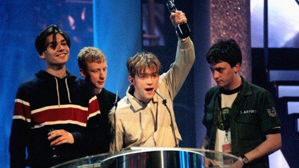 Blur win a Brit Award for Top British Artists of the year 1995. (l-r) Alex James, Dave Rowntree, Damon Albarn and Graham Coxon.