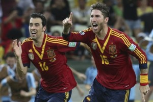 Spain's Sergio Busquets, left, and Sergio Ramos celebrate after defeating Italy 7-6 during a penalty shoot-out in the soccer Confederations Cup semifinal match at the Castelao stadium in Fortaleza, Brazil, Thursday, June 27, 2013. (AP Photo/Eugene Hos