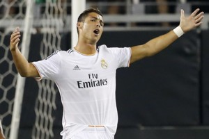 Real Madrid's Cristiano Ronaldo, right, reacts to a call during the first half of the International Champions Cup soccer match as Los Angeles Galaxy's A.J. DeLaGarza looks away, Thursday, Aug. 1, 2013, in Glendale, Ariz. (AP Photo/Matt York)