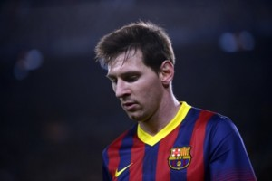 FC Barcelona's Lionel Messi, from Argentina, looks on against Rayo Vallecano during a Spanish La Liga soccer match at the Camp Nou stadium in Barcelona, Spain, Saturday, Feb. 15, 2014. (AP Photo/Manu Fernandez)