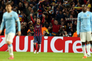 Barcelona's Lionel Messi celebrates after scoring his sides opening goal during the UEFA Champions League, Round of 16 match at the Etihad Stadium, Manchester.