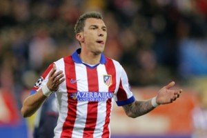 Atletico's Mario Mandzukic reacts after scoring the third goal of his team during the Champions League Group A soccer match between Atletico de Madrid and Olympiakos at the Vicente Calderon stadium in Madrid, Spain, Wednesday, Nov. 26, 2014. (AP Photo/Daniel Ochoa de Olza)