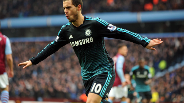Chelsea's Eden Hazard celebrates after scoring against Villa during the English Premier League soccer match between Aston Villa and Chelsea at Villa Park, Birmingham, England, Saturday, Feb 7, 2015. (AP Photo/Rui Vieira)
