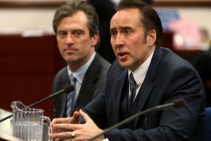 FILE - In this Tuesday, May 7, 2013 file photo, actor Nicolas Cage testifies in support of a bill proposing tax incentives to filmmakers at the Legislative Building Carson City, Nev. Cage's agent Michael Nilon is at left. Nevada lawmakers are hoping to breathe new life into a film tax credits program that was gutted while the state worked to attract Tesla. The Senate Revenue Committee is scheduled to review SB94 on Friday, Feb. 20, 2015. The measure would remove a cap that limits the state to awarding $10 million over the four years of the program, and would allow the Legislature to adjust that number.(AP Photo/Cathleen Allison)