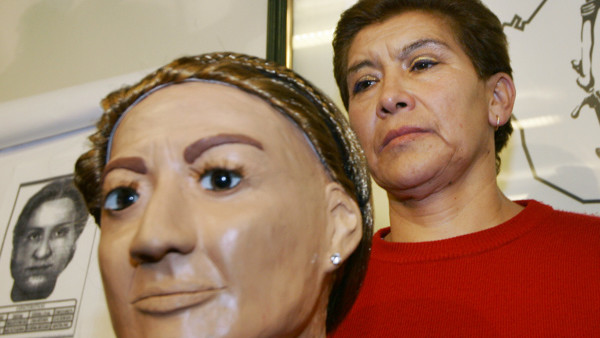 Juana Barraza, 48, is presented to the media next to a bust the police used to help in the search for a serial murder suspect at the Mexico City police headquarters Wednesday Jan. 25, 2006. Police say Barraza matches the profile of a believed serial murde