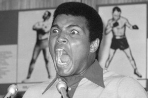 FILE - In this Aug. 29, 1974, file photo, boxer Muhammad Ali makes a face during a press luncheon in New York, to promote the sale of tickets to Madison Square Garden where the battle against George Foreman in Zaire will be shown in October on closed circ