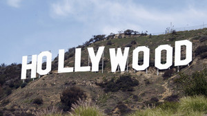 FILE - This Jan.29,2010 file photo shows the Hollywood sign as seen in the Hollywood Hills of Los Angeles. Thirty-five years after it was rebuilt, the sign's letters will be stripped down to sheet metal, primed and given a new coat of white paint. The 10-