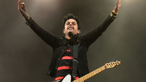Billie Joe Armstrong of Green Day performing on the Main Stage on day one of the Reading Festival.