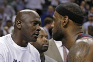 Charlotte Bobcats owner Michael Jordan, left, shakes hands with Miami Heat's LeBron James, right, after Game 4 of an opening-round NBA basketball playoff series in Charlotte, N.C., Monday, April 28, 2014. The Heat won 109-98, sweeping the series. (AP Phot