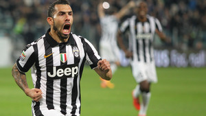 Juventus' Carlos Tevez celebrates after scoring during a Serie A soccer match between Juventus and Empoli at the Juventus stadium, in Turin, Italy, Saturday, April 4, 2015. (AP Photo/ Massimo Pinca)